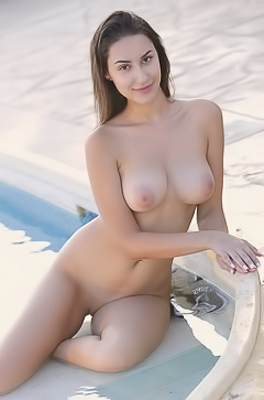 Angelina Socho Flaunts Her Beautiful Breasts In A Tight Swimsuit